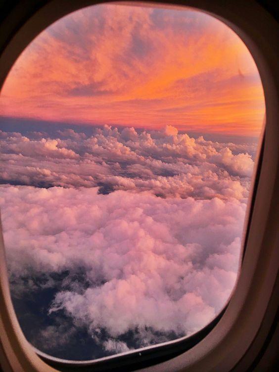 sunset flying airplane travel clouds dra martha castro noriega mexico tijuana